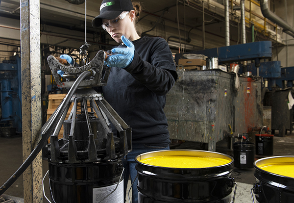 A bucket being capped in the Forrest technical coatings manufacturing process